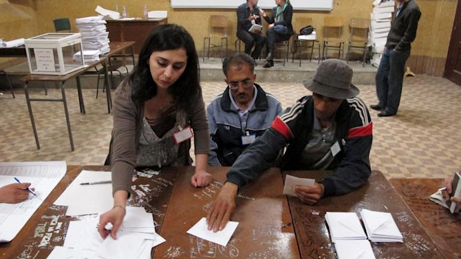 Workers at a polling station count ballots at a polling station in the Bab el-Oued neighborhood, Algiers, Thursday, May 10, 2012. As parliamentary elections unfolded across Algeria on Thursday, voting was light for much of day in the capital, despite these contests being billed the freest in 20 years. (AP Photo/Paul Schemm).