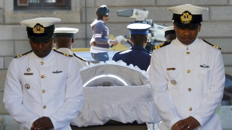 Navy officers stand guard at the coffin of former South African President Mandela in Pretoria