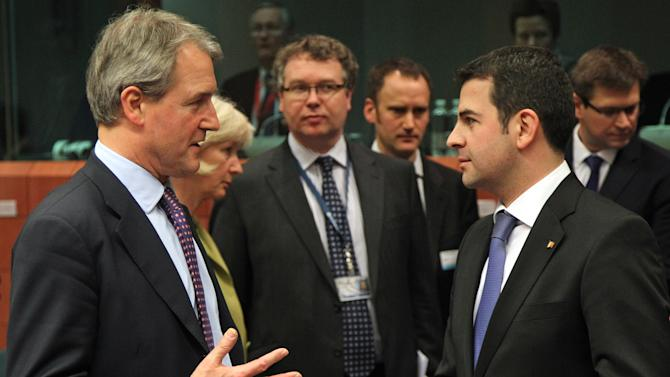 Romania's Agriculture Minister Daniel Constantin, right, talks with British Secretary of State for the Environment, Food, & Rural Affairs Owen William Paterson, at the European Council building in Brussels, Wednesday, Feb. 13, 2013. Agriculture ministers from the EU countries most affected by the scandal over horse meat found in products labeled as beef, are meeting for an exchange of information in Brussels on Wednesday evening. (AP Photo/Yves Logghe)