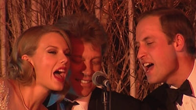 Raw: Prince William Rocks With Swift, Bon Jovi