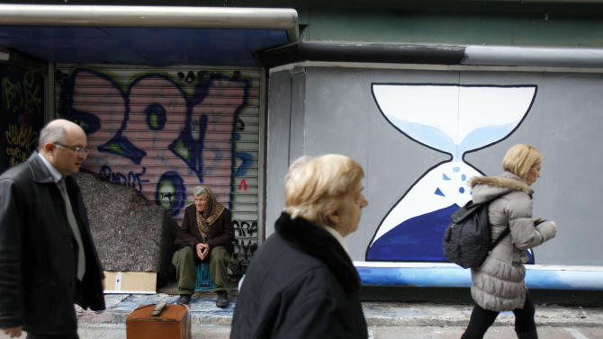 In Greece, debt deal gets a mixed reception