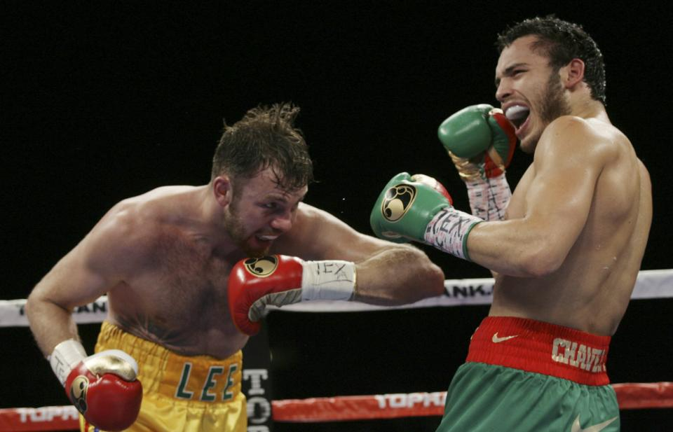Julio Cesar Chavez Jr., right, reacts after Andy Lee head-butted him during their WBC middleweight title bout Saturday June 16, 2012, in El Paso, Texas. Lee was warned by the referee. (AP Photo/El Paso Times, Victor Calzada)  EL PASO OUT   JUAREZ, MEXICO, OUT