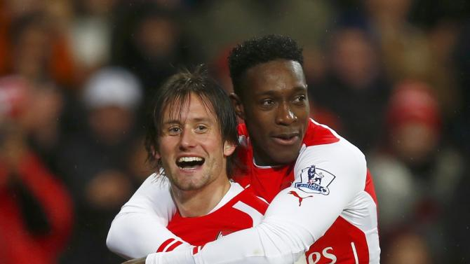 Arsenal's Tomas Rosicky celebrates with team-mate Danny Welbeck after scoring a goal against Queens Park Rangers during their English Premier League soccer match at the Emirates Stadium in London