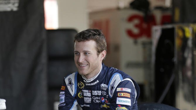 Driver Kasey Kahne talks with crew members in his garage during NASCAR auto race testing at Daytona International Speedway, Friday, Jan. 11, 2013, in Daytona Beach, Fla. (AP Photo/John Raoux)