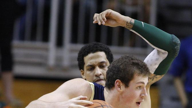 Georgia Tech's Daniel Miller (5) drives the ball on Miami's Julian Gamble during the first half of an NCAA college basketball game in Coral Gables, Fla., Wednesday, March 6, 2013. (AP Photo/Luis M. Alvarez)