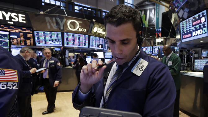Trader Craig Spector works on the floor of the New York Stock Exchange Wednesday, March 19, 2014. Stocks are slightly lower in early trading on Wall Street as traders wait for the latest policy decision from the Federal Reserve. (AP Photo/Richard Drew)