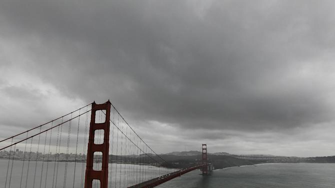 Dark clouds move over the Golden Gate Bridge in Marin County, Calif., Thursday, Nov. 29, 2012. The National Weather Service says that by late morning Thursday 1 inch of rain had fallen in several hours across the western side of the county. Much of Northern California is under a variety of warnings and advisories for rain, snow and high winds. (AP Photo/Jeff Chiu)