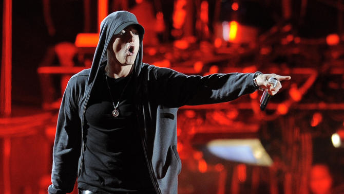 FILE - This April 15, 2012 file photo shows Eminem performing at the 2012 Coachella Valley Music and Arts Festival in Indio, Calif. Eminem and Outkast will headline this year's Lollapalooza music festival on Aug. 1-3, 2014, in Chicago. Festival founder Perry Farrell announced the lineup of more than 130 acts on Wednesday, March 26, 2014. (AP Photo/Chris Pizzello, File)
