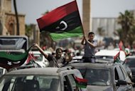 Libyans celebrate in Martyrs&#39; Square in Tripoli after voting for the Libyan General National Assembly on July 7, 2012. Libya&#39;s new congress is tasked with appointing a new interim government and steering the country for a roughly one-year transition period, until fresh elections can be held on the basis of a new constitution