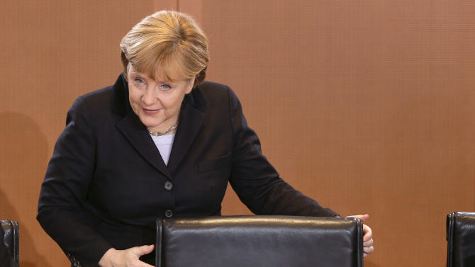 German Chancellor Angela Merkel smiles as she arrives for the weekly cabinet meeting at the chancellery in Berlin, Germany, Thursday, Dec. 6, 2012. (AP Photo/Michael Sohn)
