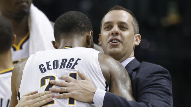 Indiana Pacers coach Frank Vogel congratulates Paul George after George was removed late in the second half of Game 4 of an Eastern Conference semifinal NBA basketball playoff series against the New York Knicks, on Tuesday, May 14, 2013, in Indianapolis. Indiana defeated New York 93-82. (AP Photo/Darron Cummings)