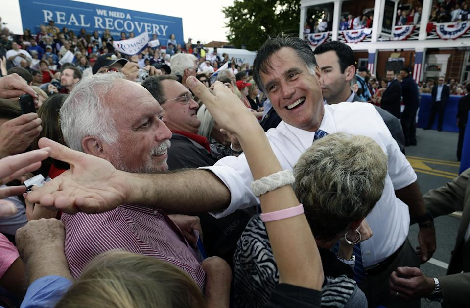 Republican presidential candidate and former Massachusetts Gov. Mitt Romney campaigns in front of The Golden Lamb Inn and Restaurant in Lebanon, Ohio, Saturday, Oct. 13, 2012. (AP Photo/Charles Dharapak)