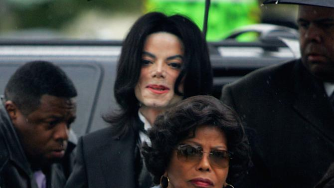 FILE - In this Monday, Feb. 28, 2005 file photo, Michael Jackson follows his mother, Katherine Jackson, as they arrive for court on the opening day of his child molestation trial at Santa Barbara County Superior Court in Santa Maria, Calif. Deputies responded to Katherine Jackson's home in Calabasas, Calif. on Monday July 23, 2012 after a family disturbance was reported. There were no arrests made, but deputies determined that two people had been involved in a physical altercation at the house and a report on a possible battery case was taken, officials said.(AP Photo/Marcio Jose Sanchez, File)