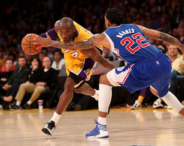 LOS ANGELES, CA - NOVEMBER 02:  Kobe Bryant #24 of the Los Angeles Lakers sdrives against Matt Barnes #22 of the Los Angeles Clippers at Staples Center on November 2, 2012 in Los Angeles, California.  The Clippers won 105-95.  NOTE TO USER: User expressly acknowledges and agrees that, by downloading and or using this photograph, User is consenting to the terms and conditions of the Getty Images License Agreement.  (Photo by Stephen Dunn/Getty Images)