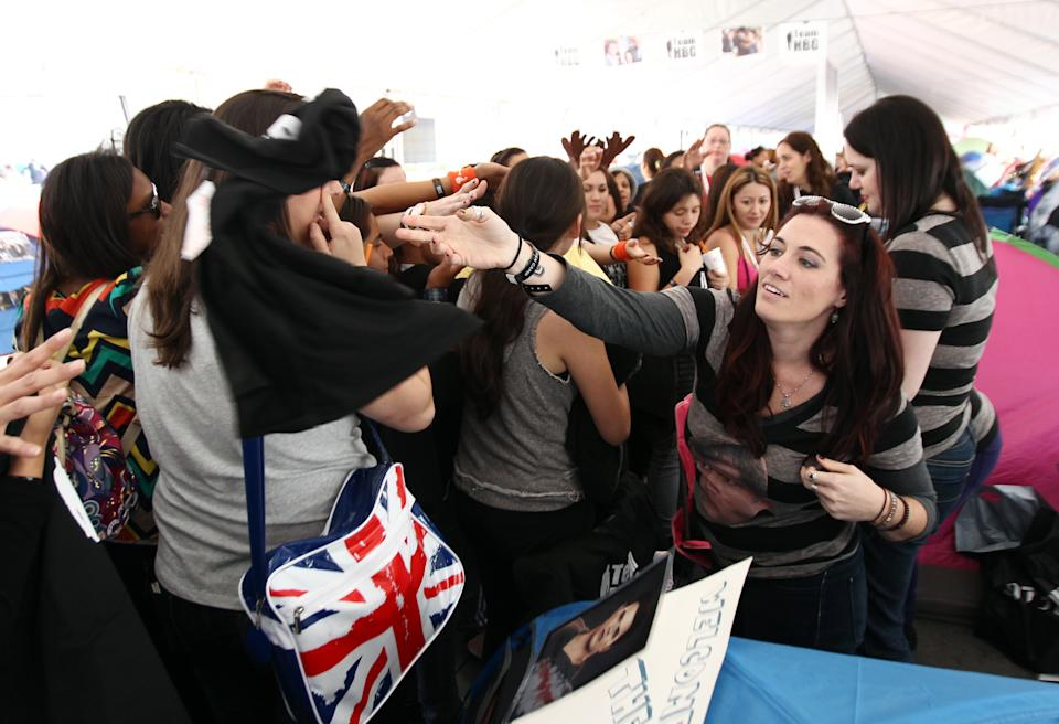 "Fans hand out T-shirts inside the Twilight fan camp ahead of the world premiere of ""The Twilight Saga: Breaking Dawn - Part 2"" on Friday, Nov. 9, 2012 in Los Angeles. The premiere will be held Nov. 12. (Photo by Matt Sayles/Invision/AP)"
