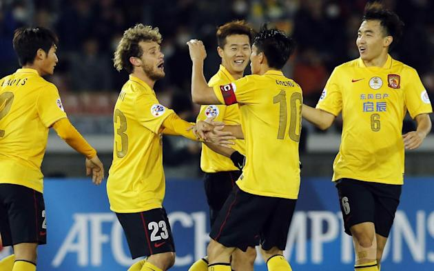 Guangzhou Evergrande's Alessandro Diamanti of Italy, second left, celebrates his goal with teammates during their group stage soccer match  against Yokohama F. Marinos at the AFC Champions League