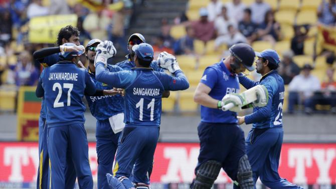 Teammates congratulate Sri Lanka's Lakmal after he took the wicket of England's Bell during their Cricket World Cup match in Wellington