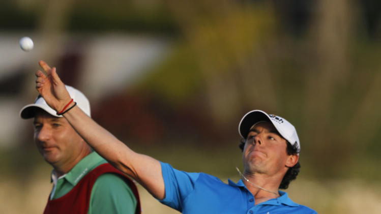 Rory McIlroy, of Northern Ireland, throws his ball after winning the Honda Classic golf tournament at 12 under par, in Palm Beach Gardens, Fla., Sunday, March 4, 2012. McIlroy became the top-ranked golfer in the world. (AP Photo/Lynne Sladky)