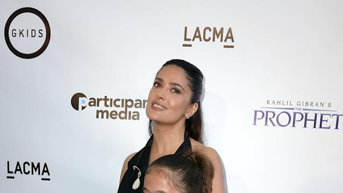 """Producer and cast member Hayek-Pinault and her daughter Pinault pose during the Los Angeles screening of Khalil Gibran's """"The Prophet"""" at Los Angeles County Museum of Art's Bing Theater in Los Angeles"""