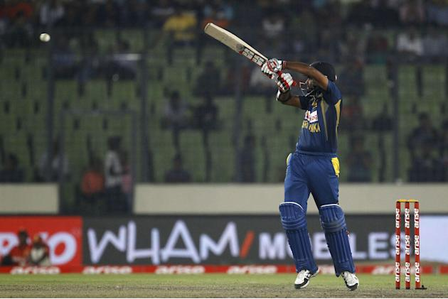Sri Lankan cricket player Lahiru Thirimanne plays a shot during the Asia Cup final cricket match between Sri Lanka and Pakistan in Dhaka, Bangladesh, Saturday, March 8, 2014. (AP Photo/A.M. Ahad)