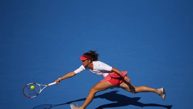 Andrea Petkovic of Germany returns the ball during her women's singles match against Simona Halep of Romania at the China Open tennis tournament in Beijing