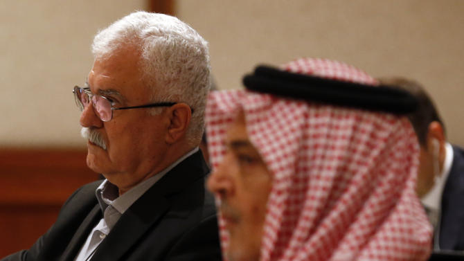 Acting head of the opposition Syrian National Coalition George Sabra, left, attends a meeting of the London 11 on Syria, also attended by Saudi Foreign Minister Prince Saud al-Faisal in Amman, Jordan, Wednesday,  May 22, 2013. (AP Photo/Jim Young, Pool)