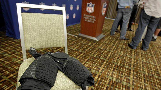 A sample of the new thigh pads the NFL made mandatory equipment for the 2013 season are displayed following a news conference at an owners meeting Tuesday, May 22, 2012, in Atlanta. (AP Photo/David Goldman)
