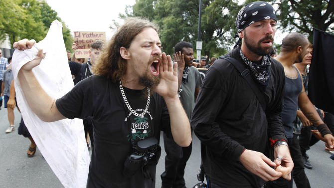 Occupy Demonstrators move in downtown in an unscheduled protest march, Tuesday, Sept. 4, 2012, in Charlotte, N.C. The Democratic National Convention begins today. (AP Photo/Chuck Burton)