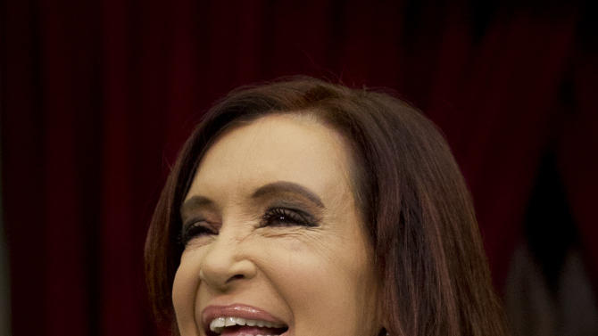 Argentina's President Cristina Fernandez holds her hand to her chest as she acknowledges supporters after entering the chamber of the Argentine National Congress in Buenos Aires, Argentina, Friday, March 1, 2013. Fernandez was on hand to inaugurate the 2013 legislative year. (AP Photo/Victor R. Caivano)