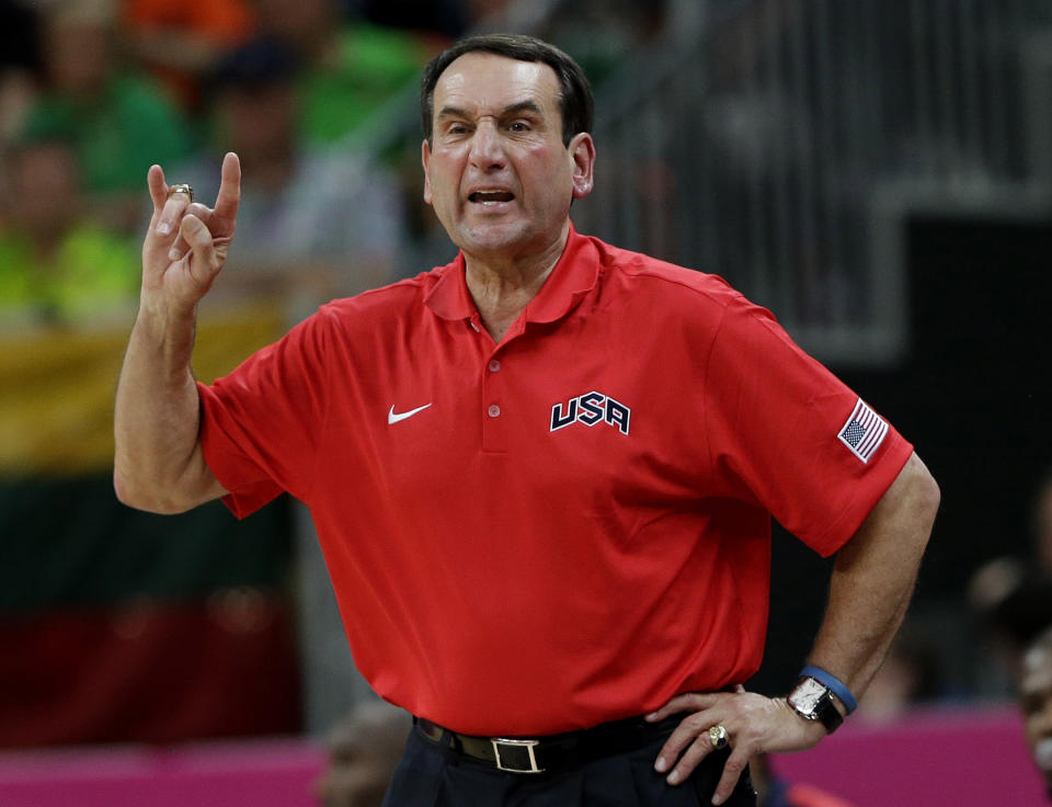 USA coach Mike Krzyzewski signals to players during a preliminary men's basketball game against Lithuania at the 2012 Summer Olympics, Saturday, Aug. 4, 2012, in London. (AP Photo/Eric Gay)