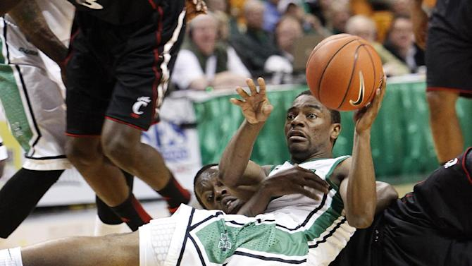 Marshall's Chris Martin, front, beats Cincinnati's Justin Jackson to a loose ball during an NCAA college basketball, Saturday, Dec. 15, 2012, in Charleston, W.Va. Cincinnati won 72-56. (AP Photo/Randy Snyder)