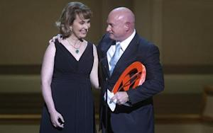 Gabrielle Giffords is hugged by her husband Mark Kelly during the Glamour Magazine Women of the Year event in New York