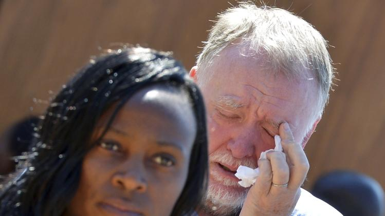 A man reacts after paying his respects to former South African President Mandela in Pretoria