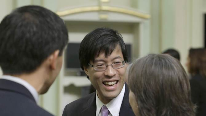 """California State Assemblyman Richard Pan, D-Sacramento, right, is seen after Gov. Jerry Brown, delivered his State of the State address at the Capitol in Sacramento, Calif., Thursday, Jan. 23, 2013. Millions of smokers could be priced out of health insurance because of tobacco penalties in President Barack Obama's health care law, say experts who are just now teasing out the potential impact of an overlooked provision in the massive legislation. """"We don't want to create barriers for people to get health care coverage,"""" said California state Assemblyman Richard Pan, who is working on a law in his state that would limit insurers' ability to charge smokers more."""" The federal law allows states to limit or change the smoking penalty. """"We want people who are smoking to get smoking cessation treatment,"""" added Pan, a pediatrician who represents the Sacramento area.  (AP Photo/Rich Pedroncelli)"""