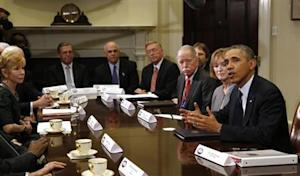 U.S. President Obama meets with health insurance chief executives at the White House in Washington