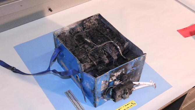 This undated image provided by the National Transportation Safety Board shows the burned auxiliary power unit battery from a JAL Boeing 787 that caught fire on Jan. 7, 2013, at Boston's Logan International Airport.  Federal officials said on Wednesday, Jan. 16, 2013, that they are temporarily grounding Boeing's 787 Dreamliners until the risk of possible battery fires is addressed. (AP Photo/National Transportation Safety Board)