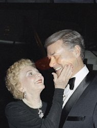 "FILE - In this Sunday, Feb. 3, 1986 file photo, actress Mary Martin touches the cheek of her son, Larry Hagman, also a famous actor, at the after-theater party for ""Legends,"" a play starring Martin and Carol Channing, at the Music Center in Los Angeles. Actor Larry Hagman, who for more than a decade played villainous patriarch JR Ewing in the TV soap Dallas, has died at the age of 81, his family said Saturday Nov. 24, 2012. (AP Photo/Reed Saxon, File)"