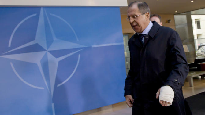 Russian Foreign Minister Sergey Lavrov is seen with a bandaged hand as he arrives for a meeting of NATO foreign ministers at NATO headquarters in Brussels on Tuesday, Dec. 4, 2012. NATO foreign ministers are expected to approve Turkey's request for Patriot anti-missile systems to bolster its defense against possible strikes from neighboring Syria. (AP Photo/Virginia Mayo)