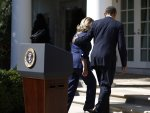 U.S. President Barack Obama and Secretary of State Hillary Clinton walk back to the Oval Office after a statement following the death of the U.S. Ambassador to Libya, Chris Stevens, and others, in the Rose Garden of the White House in Washington