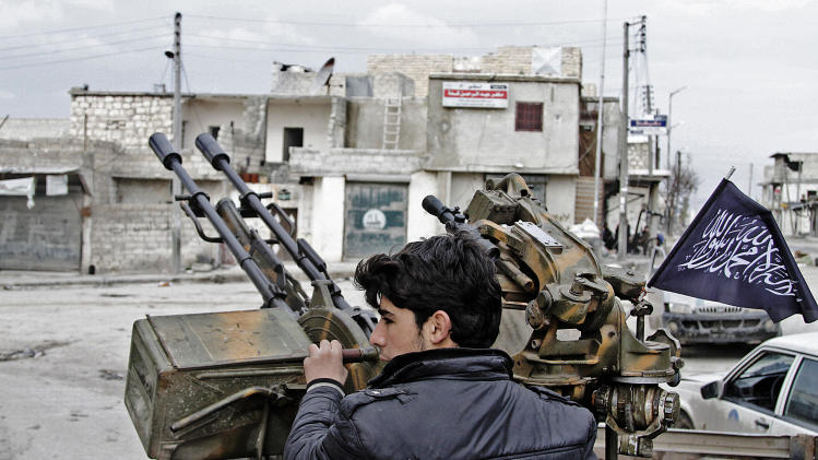 In this Friday February 8, 2013, photo, a Free Syrian Army fighter sits behind an anti-aircraft weapon in Aleppo, Syria. Syrian rebels brought their fight within a mile of the heart of Damascus on Friday, seizing army checkpoints and cutting a key highway with a row of burning tires as they pressed their campaign for the heavily guarded capital, considered the likely endgame in the nearly 2-year-old civil war. (AP Photo/Abdullah al-Yassin)