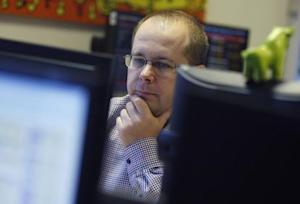 A currency trader reacts at his desk in Budapest