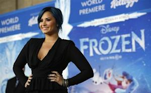 "Singer Lovato, who is featured on the soundtrack, poses at the premiere of ""Frozen"" at El Capitan theatre in Hollywood"