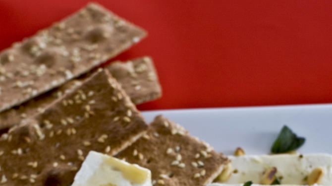 In this undated image, feta cheese and honey are shown served on a platter in Concord, N.H. (AP Photo/Matthew Mead)