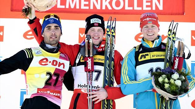First placed Tarjei Boe (C) of Norway flanked by second placed Martin Fourcade (L) of France and third placed Andriy Deryzemlya (R) of Ukraine pose duringa ceremony of the IBU Biathlon World Cup sprint in Oslo (AFP)