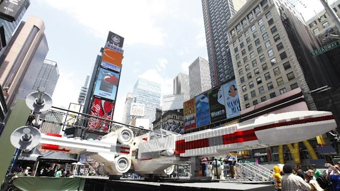 A view of the world's largest LEGO Model, a 1:1 replica of the LEGO Star Wars X-wing Starfighter that took 32 Model Builders, 5.3 million LEGO bricks and over 17,000 hours to complete, after it's unveiling in New York City's Times Square, Thursday May 23, 2013. (Amy Sussman/AP Images for The LEGO Group)
