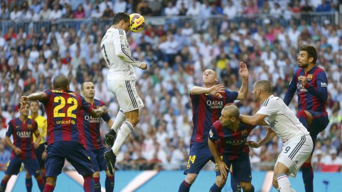 "Real Madrid's Ronaldo heads the ball but fails to score against Barcelona during their Spanish first division ""Clasico"" soccer match at the Santiago Bernabeu stadium in Madrid"