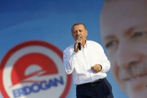 Turkey's Prime Minister and presidential candidate Erdogan addresses his supporters during an election rally in Istanbul