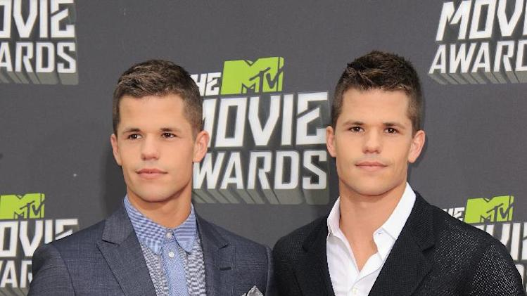 Charlie Carver and Max Carver arrive at the MTV Movie Awards in Sony Pictures Studio Lot in Culver City, Calif., on Sunday April 14, 2013. (Photo by Jordan Strauss/Invision/AP)