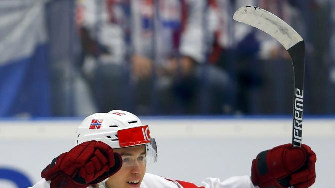 Norway's Rosseli Olsen celebrates his goal during their ice hockey World Championship game against Slovakia in Ostrava