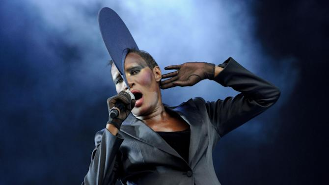 FILE - In a Sunday, July 3, 2011 file photo, Jamaican singer, Grace Jones performs at the Wireless Festival at Hyde Park, in London. Gallery, an imprint of Simon & Schuster, announced Wednesday, Sept. 18, 2013 that Jones, who once vowed she'd never write a memoir, has an agreement with Gallery Books for a book scheduled to come out in the fall of 2014.(AP Photo/Jonathan Short, File)
